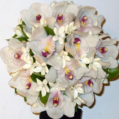 Wired posy of Cymbidium orchids and stephanotis