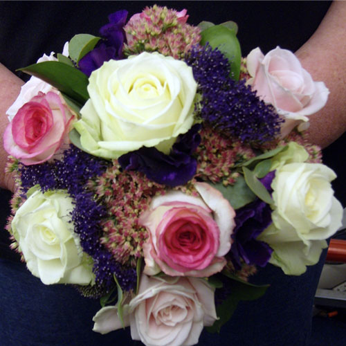 Handtied posy of dolce vita, avalanche and sweet avalanche roses, sedum and trachilium