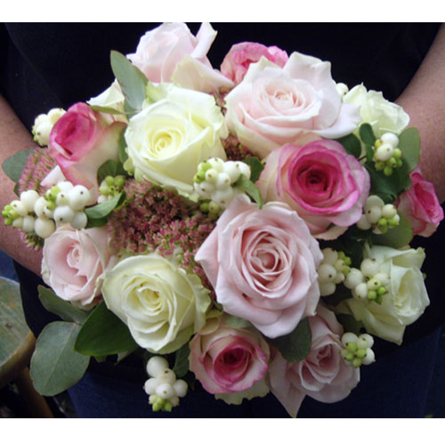 Handtied posy of dolce vita, sweet avalanche and avalanche roses, sedum and snowberry